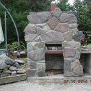 outdoor granite fireplace under construction