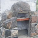 outdoor granite fieplace under construction